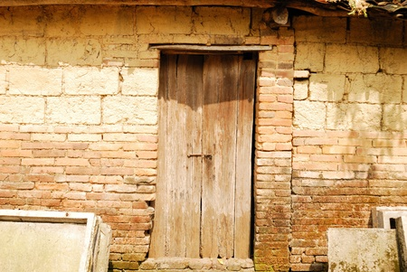 The old brick house with wooden doors Nigeria photo