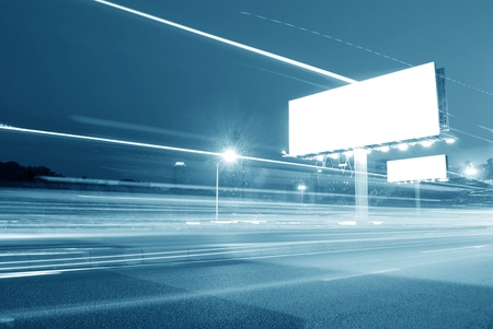 Blank billboard in the city with heavy traffic Stock Photo