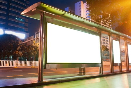 Blank billboards on to the bus station photo
