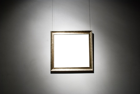 frames on white wall in art museum photo