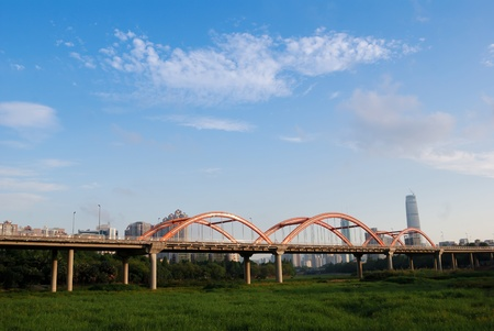 road through the bridge with blue sky background of a city. photo