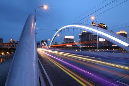 Modern city bridge at night photo