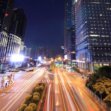 Urban landscape at night and through the citys traffic photo