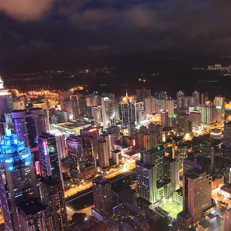 High-altitude aerial view of the city at night photo