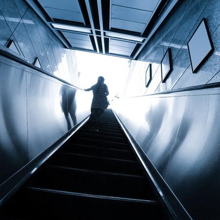 escalator with passengers motion blur photo