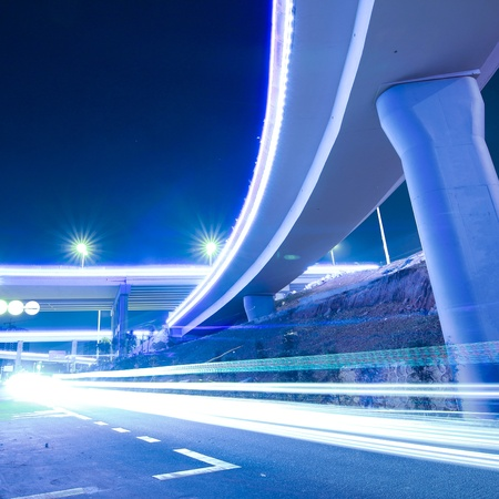 Viaduct car traveling light trails at night Stock Photo - 11394434