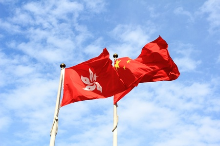 flaunt: flags of China and Hong kong with blue sky