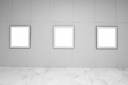 empty frames in a room against a white wall Stock Photo - 12222441