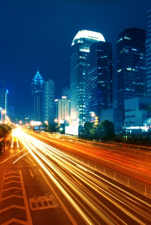 the light trails on the modern building background Stock Photo