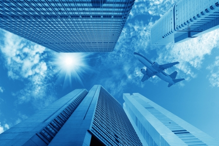 corporate airplane: air travel with modern building in China Stock Photo