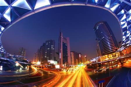 the light trails on the modern building background in  china photo