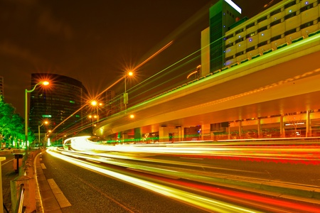light trails on urban road in rush hour traffic at night photo