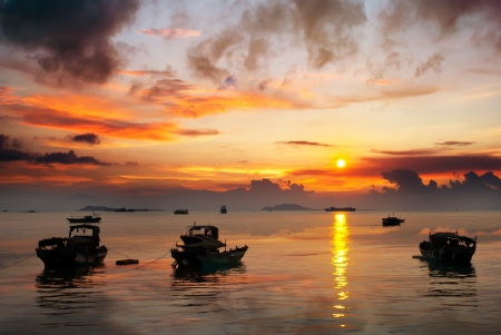 China Hainan,shanya sunset silhouette and boats photo