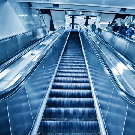 Wide escalators stairways inside modern office corporate buildings