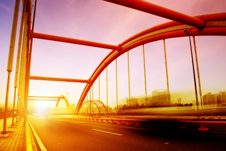 road through the bridge with blue sky background of a city Stok Fotoğraf