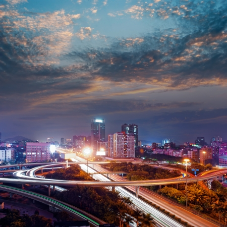Freeway in night with cars light in modern city Stock Photo - 13726080