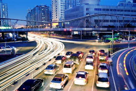 traffic building: moving car with blur light through city at night
