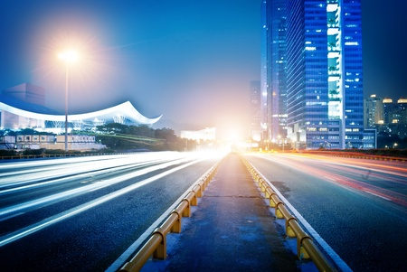 moving car with blur light through city at night Stock Photo - 13726537