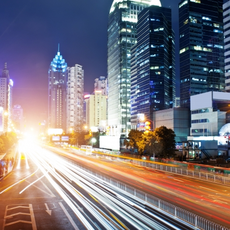 guangdong: moving car with blur light through city at night