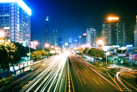 moving car with blur light through city at night Stock Photo - 13726732