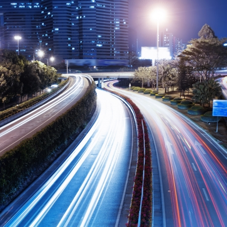 moving car with blur light through city at night photo