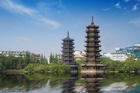 golden tower and silver tower in the lake