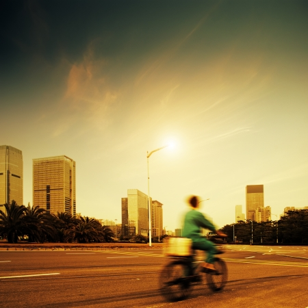 The courier in Chinese Shenzhen at dusk photo