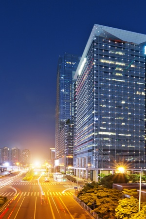 the light trails on the modern building background in shenzhen  china photo