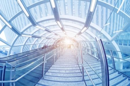 escalator with passengers motion blur