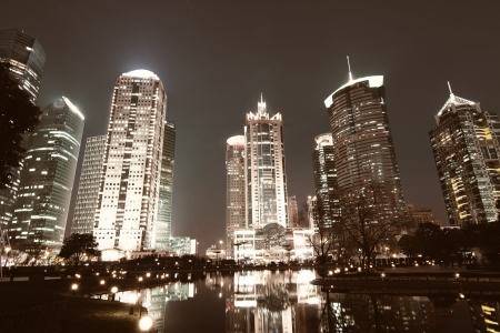 beautiful night view of modern buildings in shanghai photo