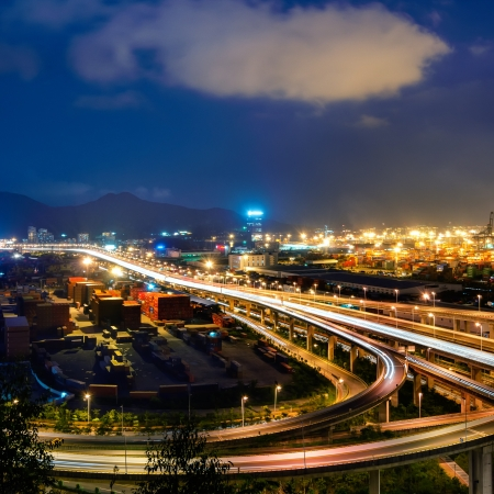 Freeway in night with cars light in modern city photo