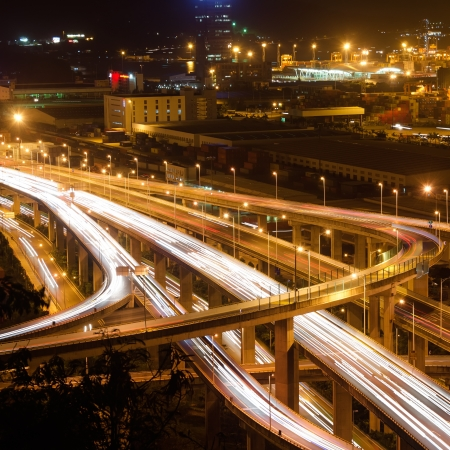 imports: Freeway in night with cars light in modern city