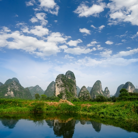 waterway: karst mountain landscape and reflection in yangshuo, guilin, China Stock Photo