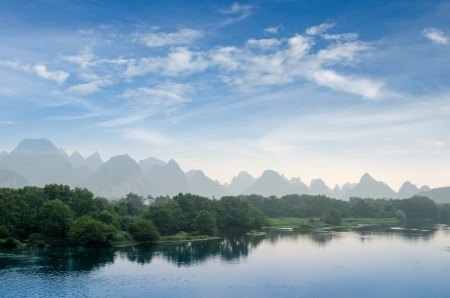 karst mountain landscape and reflection in yangshuo, guilin, China photo