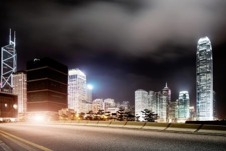doom: Highway and city at night Stock Photo