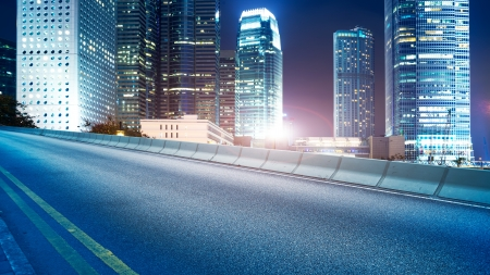 Highway and city at night photo