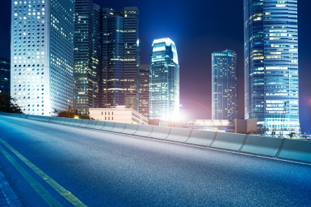 Highway and city at night Stock Photo