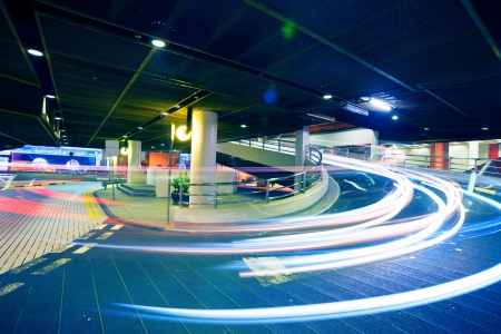 Car light trails in the parking lot Standard-Bild