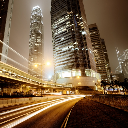 futuristic city: Fast moving cars at night