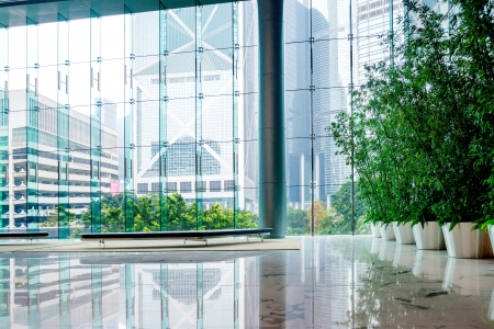 green office: Glass wall in the office building Stock Photo