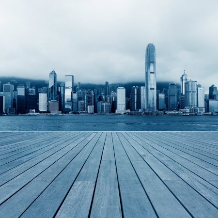 city landscape: Wooden platform and urban background at hongkong