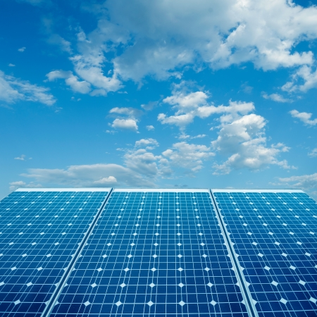 solar roof: photovoltaic cells and sunlight background