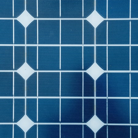 photovoltaic cells and sunlight background photo
