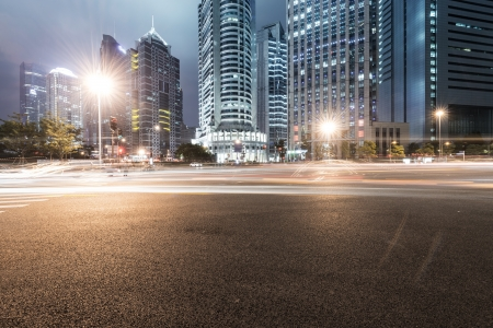 city street: the light trails on the modern building background in shanghai china