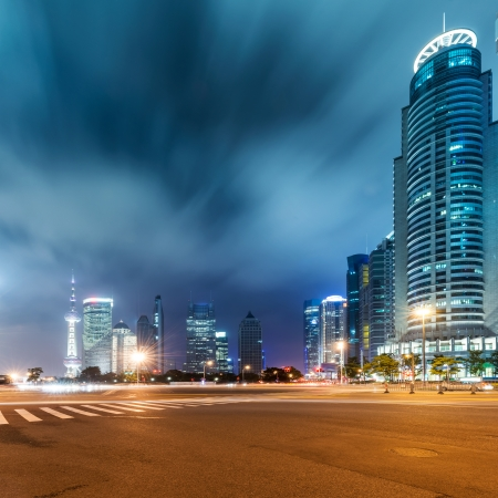 highway at night: Shanghai Lujiazui Finance and Trade Zone of the modern city night background