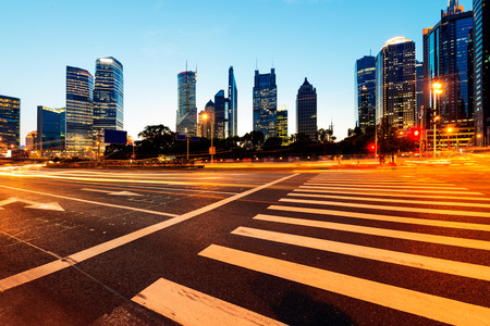 Urban city at night with traffic and night skyline photo