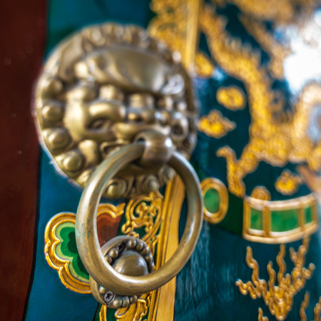 Chinas the lions head the handle on the door photo