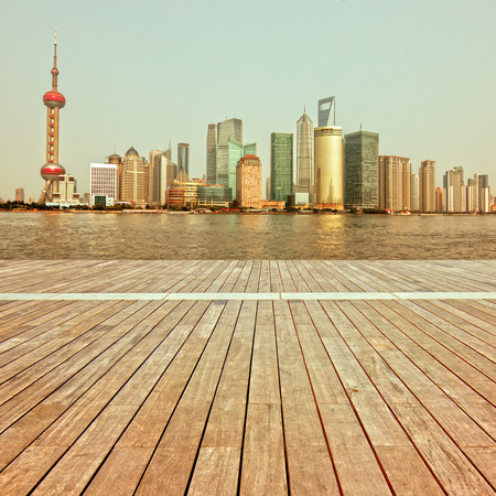 shanghai skyline in afternoon and reflection with wooden floor Editorial