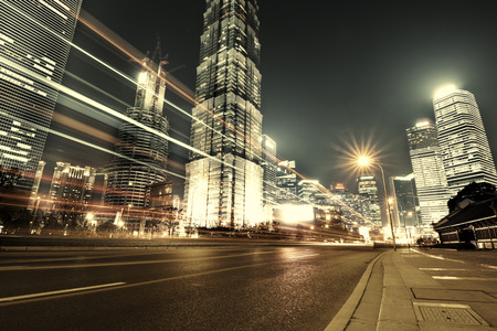 fast car: Shanghai Lujiazui Finance and Trade Zone of the modern city night background
