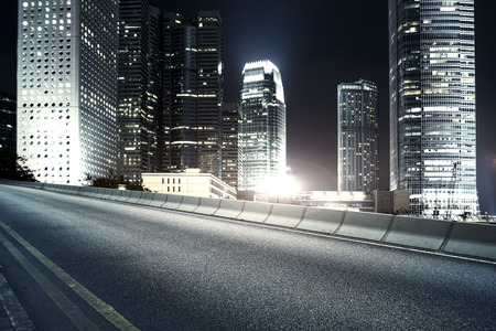 night road: Highway and city at night Stock Photo